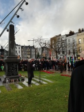 Member of the Irish Defence Forces laying a wreath